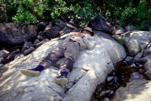 Jim tries to nap on a rock.