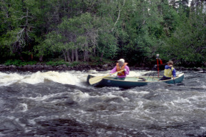 Rob and Larry enter class III rapids.